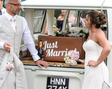 Happy Couple arriving for their wedding reception with wedding DJ in Cornwall.
