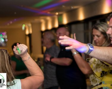 Hands in the air celebrating with friends on the dance floor with Party Dj Cornwall