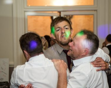 Man Hug on the dance floor celebrating Russ & Pia Wedding with Party DJ Cornwall.
