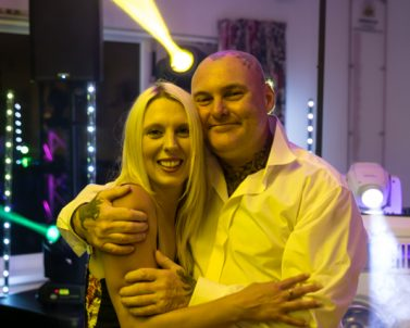 Happy loving couple at friends wedding with party dj Cornwall
