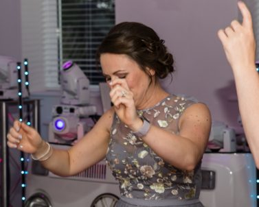 Wedding Bridesmaid letting their hair down having fun on the dance floor with Wedding DJ Cornwall.