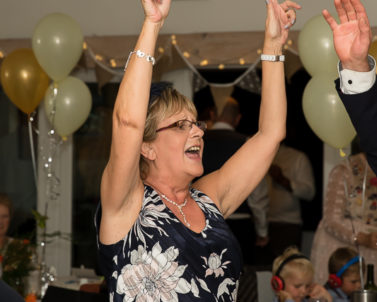 Arms in the air having a fantastic party with music blasting out by Wedding DJ Cornwall.