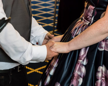 Holding hands at the ceremony with wedding Dj Cornwall.