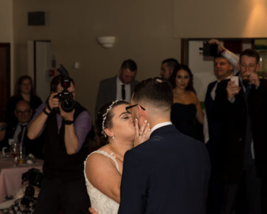 The Happy Bride & Groom kissing on the dance floor while dancing their first dance with Wedding DJ Cornwall