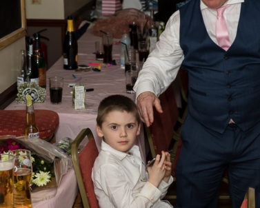 One of the young children playing with playstation until his favourite track request is played by wedding DJ Cornwall.