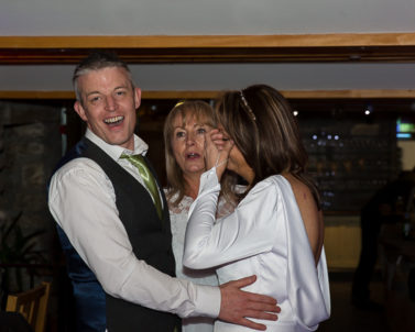 Groom and Bride with step sister enjoying the moment on the dance floor